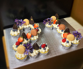 Cupcakes with fresh fruit and macarons