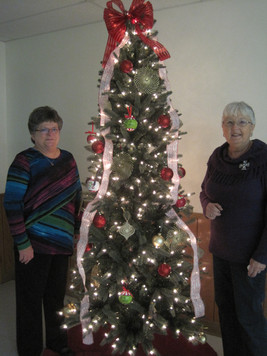 2015 - Susan and Sue decorating the Pratt Area 4-H Center for worship