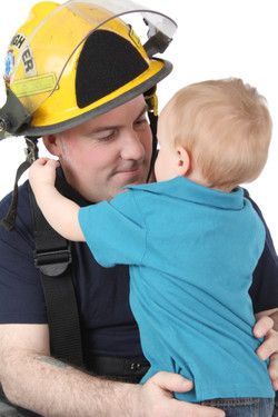 Toddler son of a fireman looking at him
