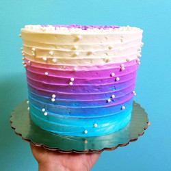 White, purple, blue ombre cake