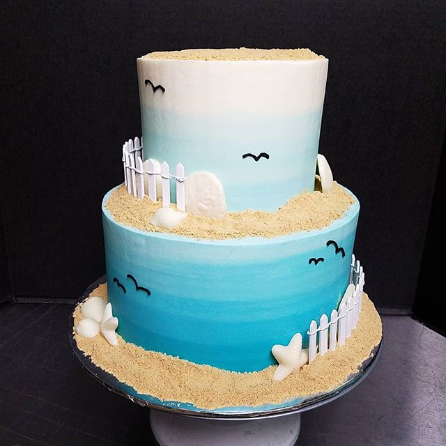 Ombre aqua beach themed wedding cake 🌊�