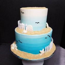 Ombre aqua beach themed wedding cake 🌊�