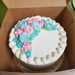 Sweet buttercream flowers for a gender r
