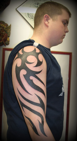 Tribal TattooFreehand by Powder The Red
