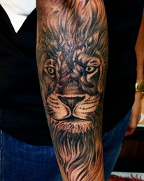Lion Tattoo by The Red Parlour Tattoo Wo
