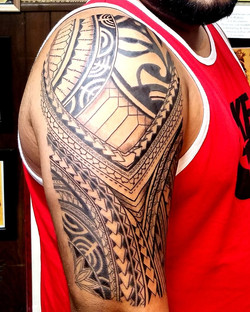 Polynesian Half Sleeve Tattoo with Mask