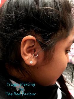 Tragus Piercing The Red Parlour Tattoo a