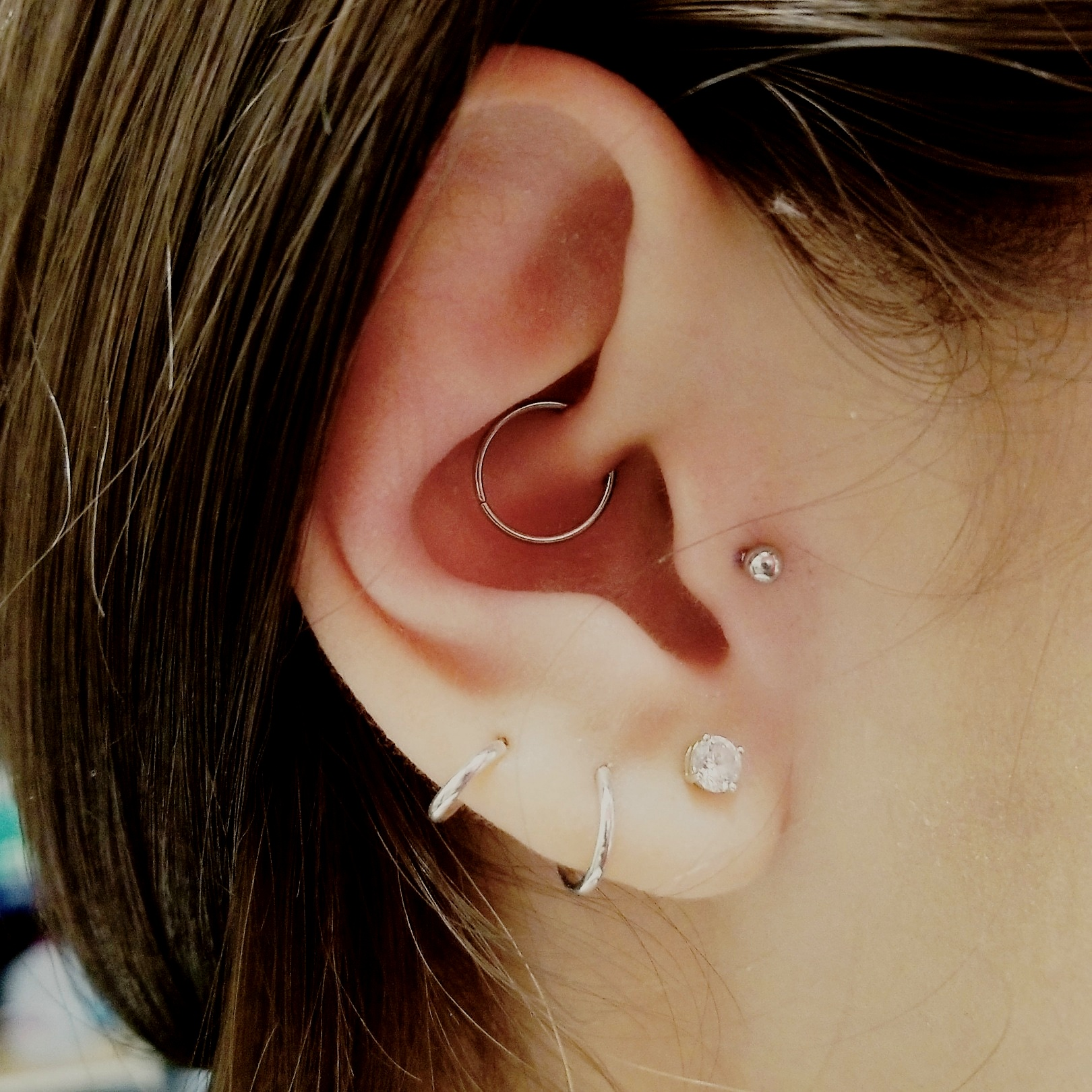 Daith Piercing by The Red Parlour Tattoo