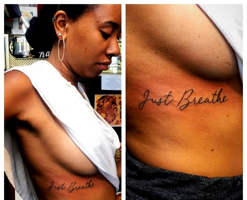 Cursive Tattoo side of breast by The Red