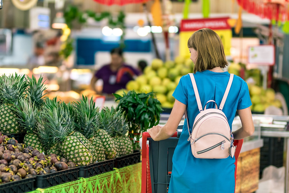 Lady in the supermarket. Photo by Artem Beliaikin from Pexels