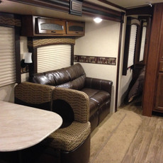 White Hawk: Pull out sofa bed (double), dinette table converts into a twin bed.