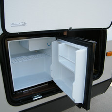 White Hawk: Small outdoor refrigerator. This unit does NOT have a camp stove on the outside.  But a grill can be rented for an additional fee.