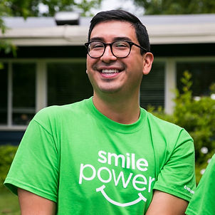 Male volunteer smiling