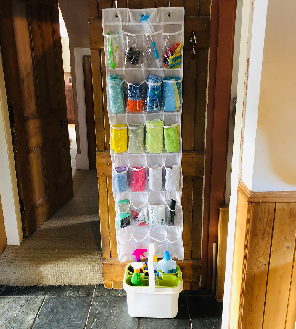 over the door shoe holder with cleaning products organised into it.