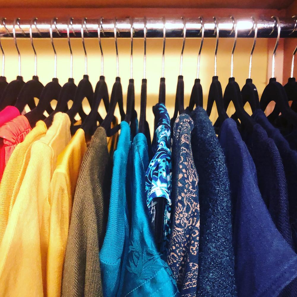 Clothes organised on velvet hangers