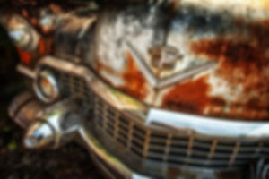 Front end of a rusty Cadillac