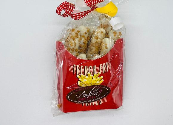 White chocolate and crispy caramel coated pretzels