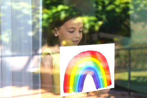 Little girl with picture of rainbow near