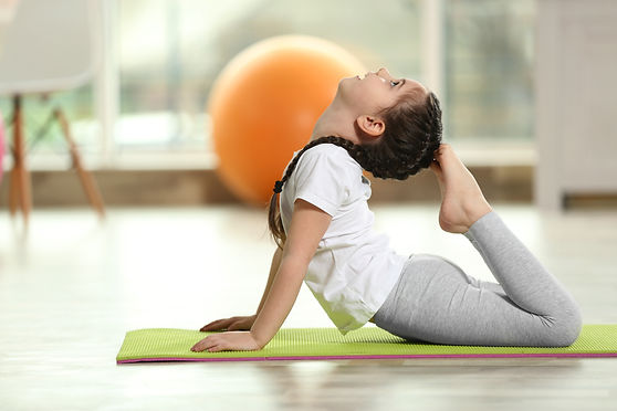Little cute girl practicing yoga pose on