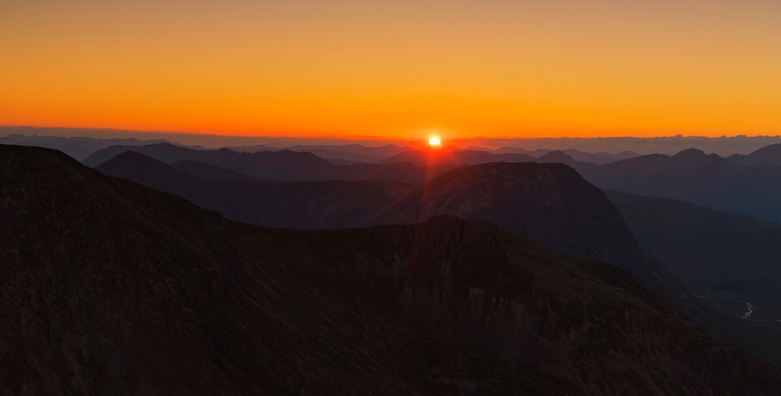 Setting sun over the Glencoe giants