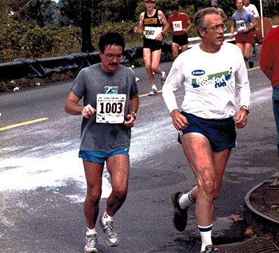 Dick Bodyfelt and Peter Chamberlain at Peter's first marathon in 1986 (20-mile mark for Peter; 100 yards for Dick)