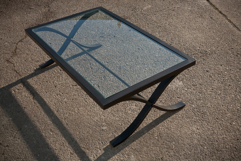 Glass and formed steel leg table