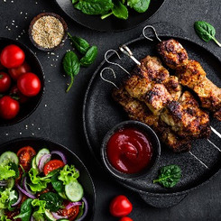 Grilled meat skewers, shish kebab and he