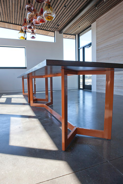 Orange conference table with fir top