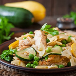 Pasta with zucchini, chicken and green p