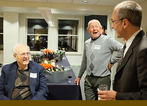 Retired partners (from left) Dick Bodyfelt and Roger Stroup enjoy laughs and drinks with current partner Rick Lee.