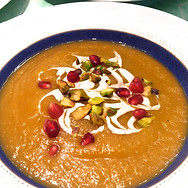 Butternut Squash Soup with Goat Cheese Drizzle, Pistachios & Pomegrante.