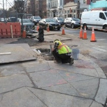 Omni finishing the traffic signal foundation at the corner of T Street & 14th Street NW