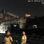 Crane lifting girder from bridge 1016