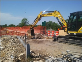 Demolition in progress on AFW Bridge # 1016 Abutment A (I-295NB) over South Capitol St. SEB on Wing wall, Moment Slab, limit of approach slab location and Backwall.