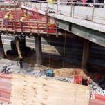 Excavating for bridge jacking foundation