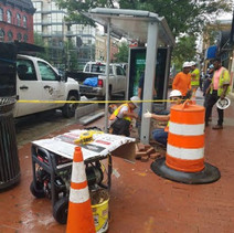 Clear Channel removing glass from bus shelter prior to removal