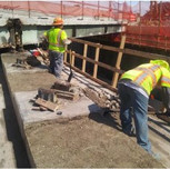 """2-3"""" Chipping and demolition on AFW Bridge # 1016 on pier cap and beam."""