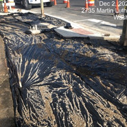 Placement of vapor barrier in preparation for PCC sidewalks at SB between cypress and Milwaukee intersection