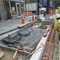 Brick gutter placement and sidewalk section ready for placement at NEC of 14th & U St.