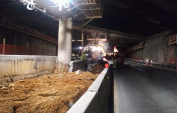 Debris stockpiled for removal on next day activity along ACFE Bridege 1017 (I-295 SB) over South Capitol St. SW approximately from Sta.103+50 to Sta.102+40.