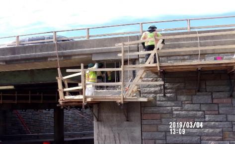 Demolishing Bridge 1016 Abutment A east cheek wall