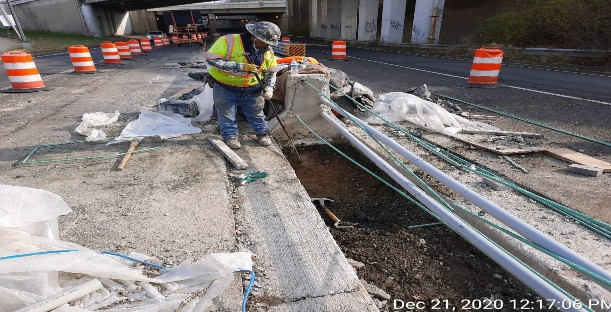 Hand Digging at Median Barrier Foundation, East Approach.