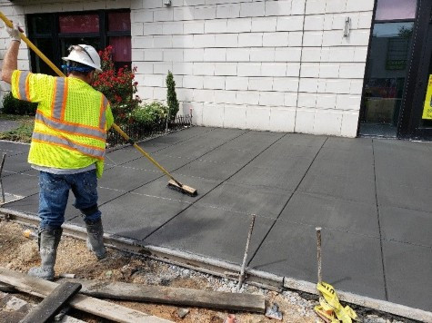 DEN Concrete finishers placed and finished Sidewalk PCC at NWC of 14th ST. and W St. NW.