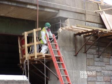 Demolishing cheek wall on Bridge 1016 Abutment A