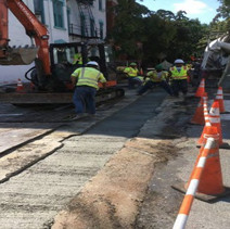 Placing PCC Base over PVC conduit trench