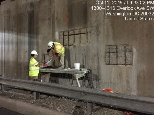 Installing bolts and welded wire fabric on concrete repair bridge 1017 abutment B stemwall