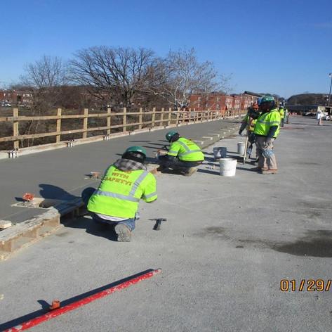 Placing Sidewalk Concrete, North Bridge.