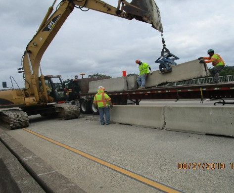Removing Precast Barrier from South Bridge.
