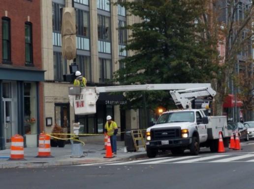 FMCC electrical crew adjusting signals at Q St