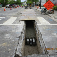 CPDC placed the concrete collar over the conduits in the utility trench